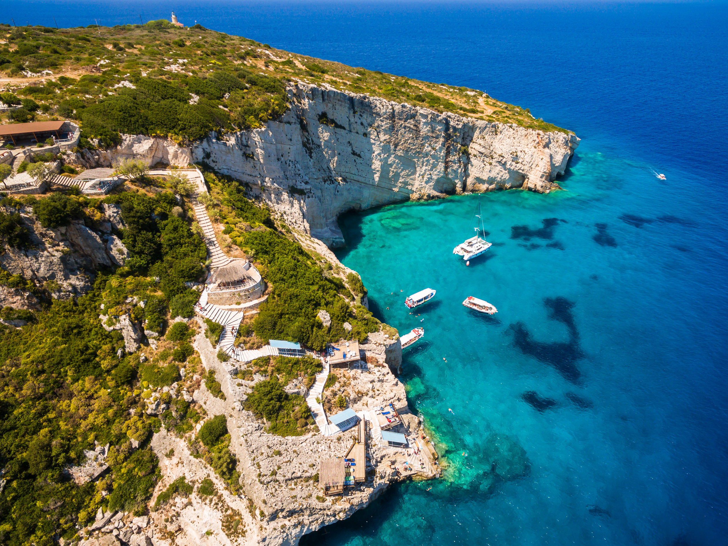 aerial-view-of-agios-nikolaos-blue-caves-in-PSX4W6A.jpg