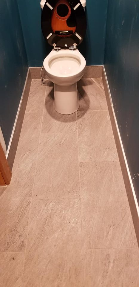 New tile flooring in a small powder room.