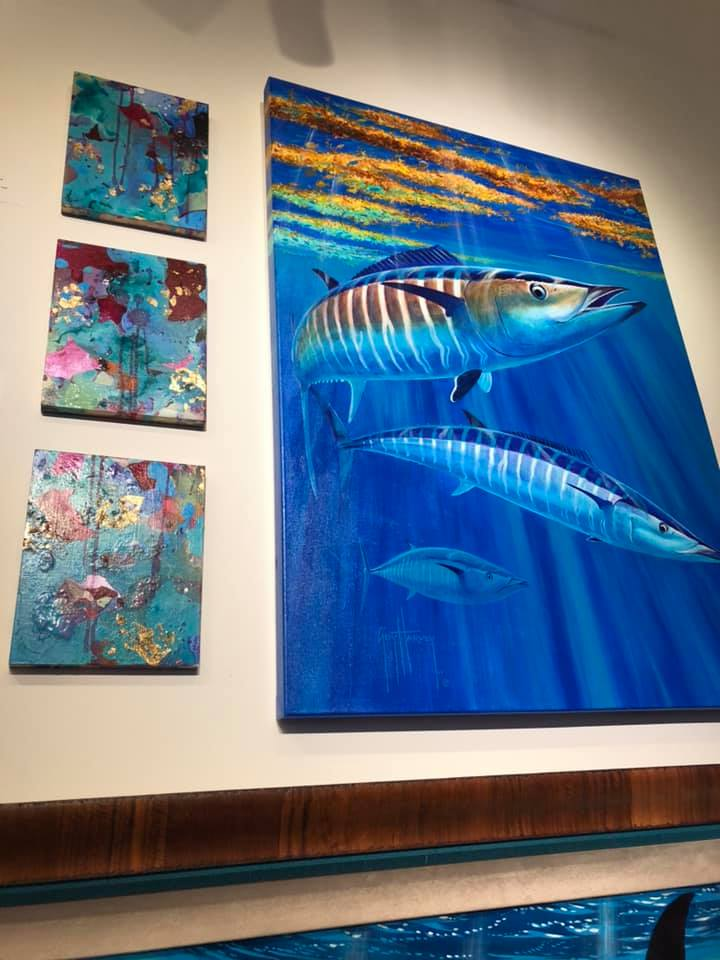 Small Untitled works next to Jamaican marine wildlife artist and conservationist, Guy Harvey.