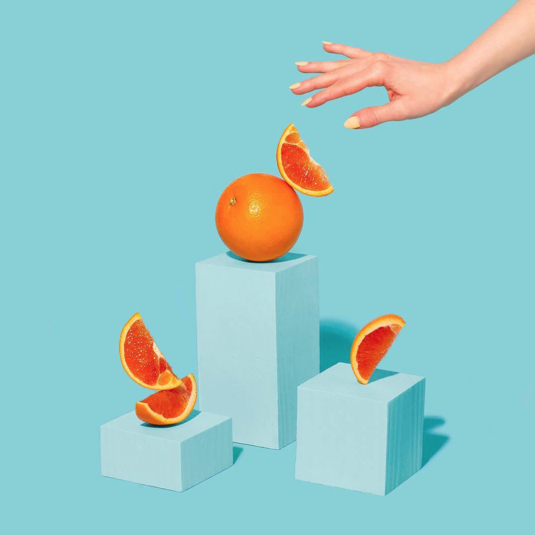 Oranges on blue background | Amy Shamblen, creative photographer | Masters of Content Creation,  The Content Designer Blog.