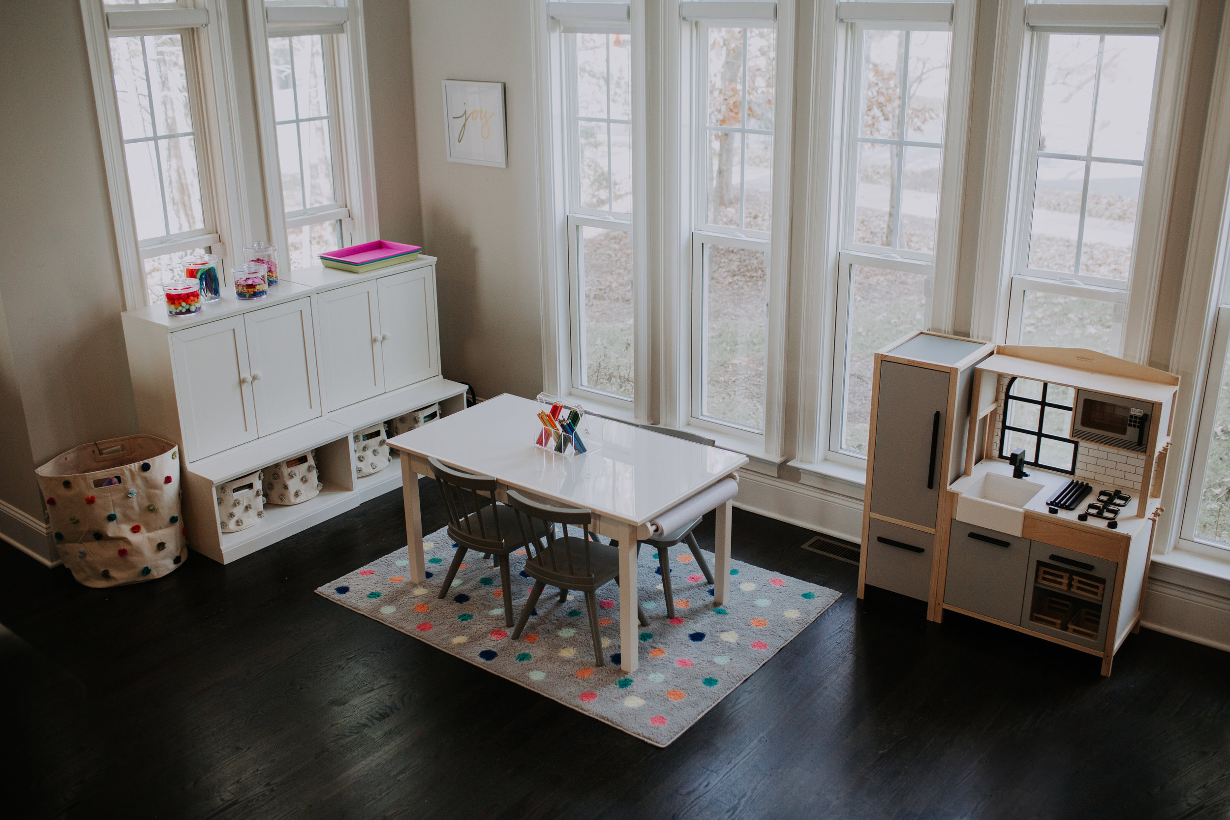 I mean!!!! GIVE ME ALL THE HEART EYES!! I also wanted a modern play kitchen in this space for the kids! I think it's a great toy to add in a small space for kids. They love to imagine and cook for me.