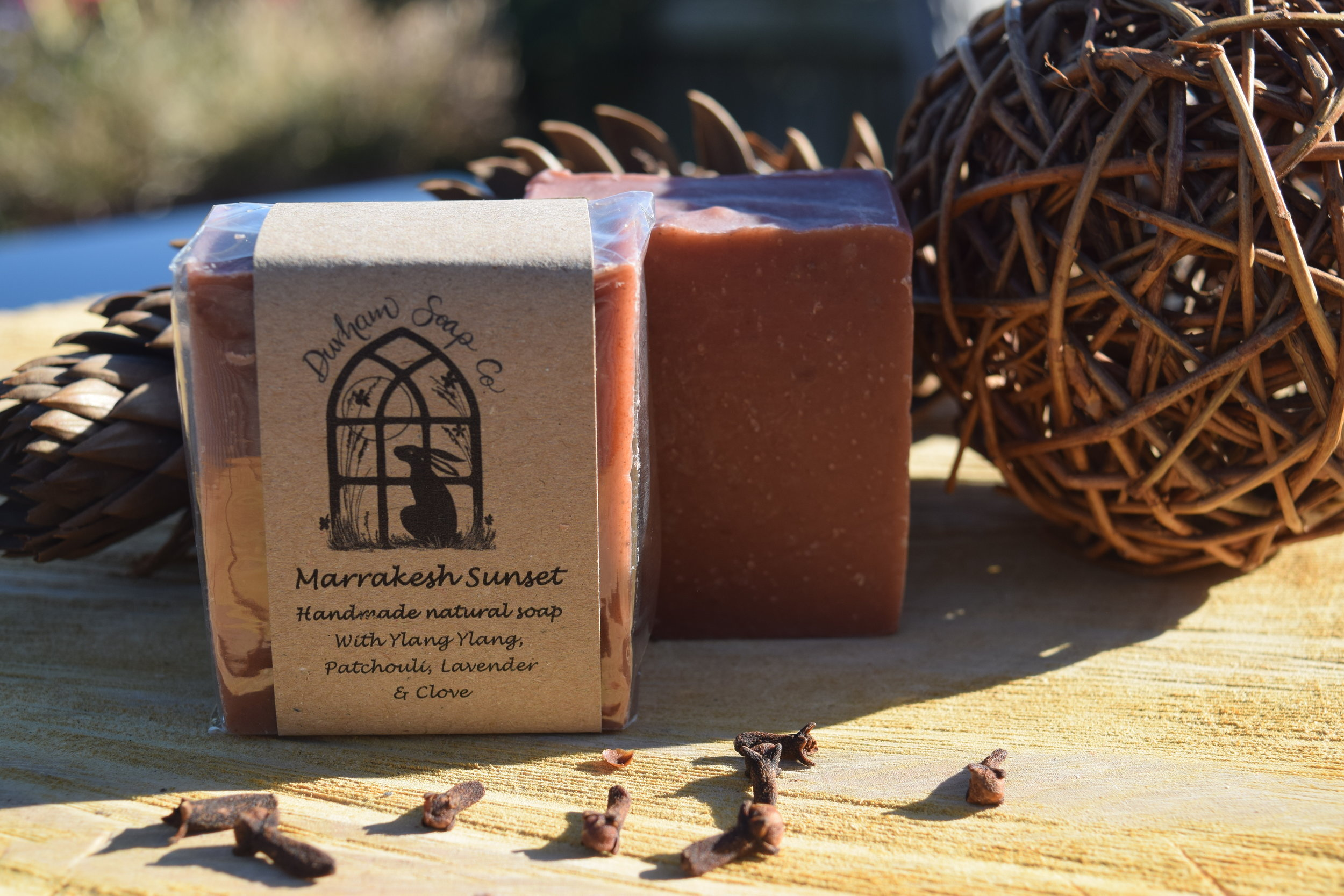 Marrakesh Sunset - Natural soap, handmade with our blend of pure plant oils, enriched with moisturising shea butter, cocoa butter and castor oil for a rich and creamy lather. Our soap also contains natural Moroccan lava clay for its detoxifying properties and its rich red colour and is fragranced with a blend of ylang ylang, patchouli, lavender and clove essential oils to tantalise the senses with the rich scents of the spice route; camel caravans laden with their precious cargo of silks and spices heading from East to West via the souks of Marrakesh.Ingredients: Olive oil, coconut oil, sunflower oil, shea butter, cocoa butter, water, castor oil, Moroccan lava clay, ylang ylang oil, patchouli oil, lavender oil, clove bud oil, Vitamin E, benzyl benzoate*, benzyl salicylate*, eugenol*, farnesol*, geraniol*, linalool*, * = occurs naturally in essential oils.Net weight: 100 g