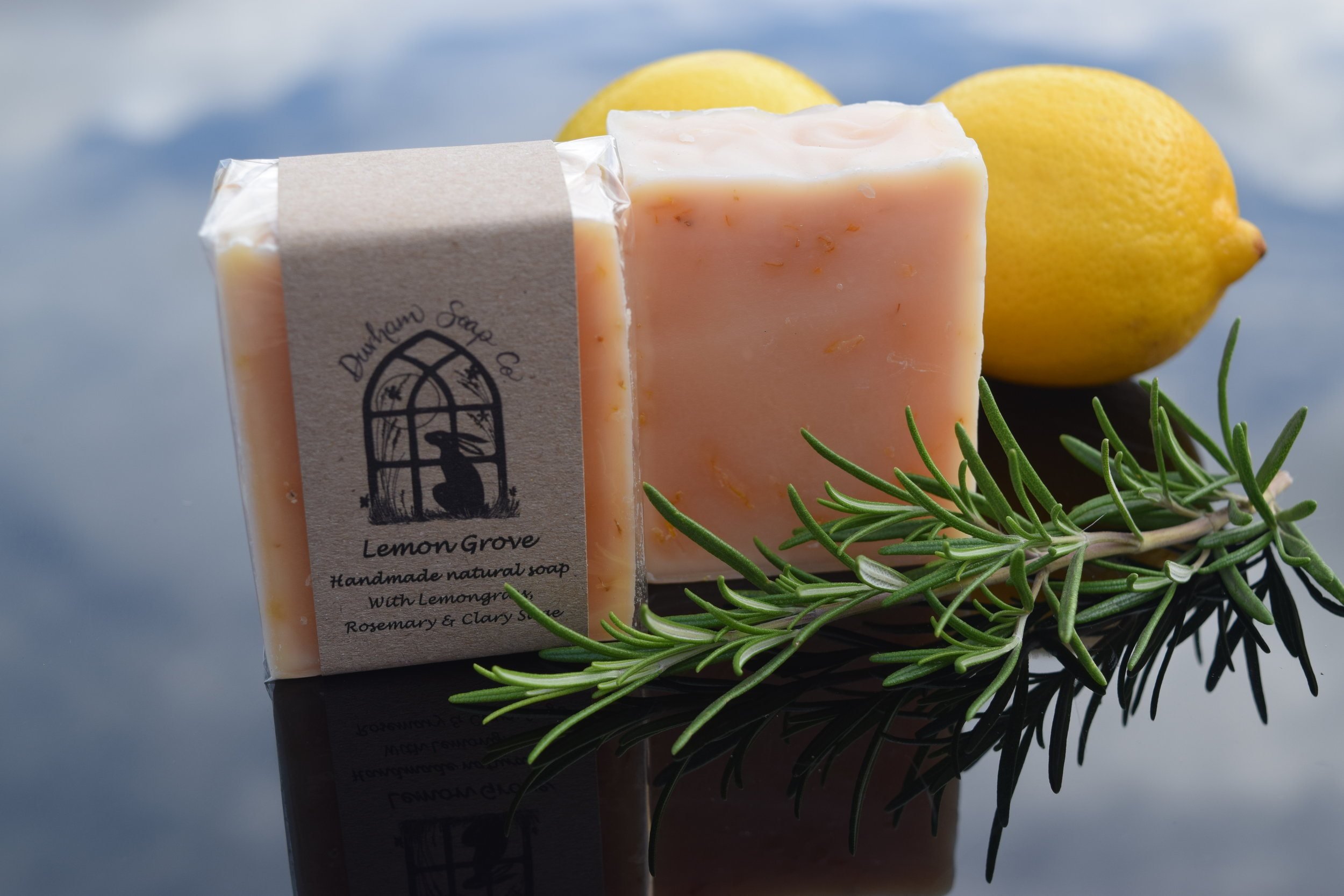 Lemon Grove - Natural soap, handmade with our blend of pure plant oils, enriched with moisturising shea butter, cocoa butter and castor oil for a rich and creamy lather. Our soap is infused with golden calendula petals and fragranced with a blend of lemongrass, may chang, rosemary and clary sage essential oils to evoke the invigorating, citrus and herbal scent of an Italian lemon grove.Ingredients: Olive oil, coconut oil, sunflower oil, shea butter, cocoa butter, water, glycerin, castor oil, lemongrass oil, may chang oil, rosemary oil, clary sage oil, calendula flowers, Vitamin E, citral*, limonene*, linalool*, * = occurs naturally in essential oils.Net weight: 100 g