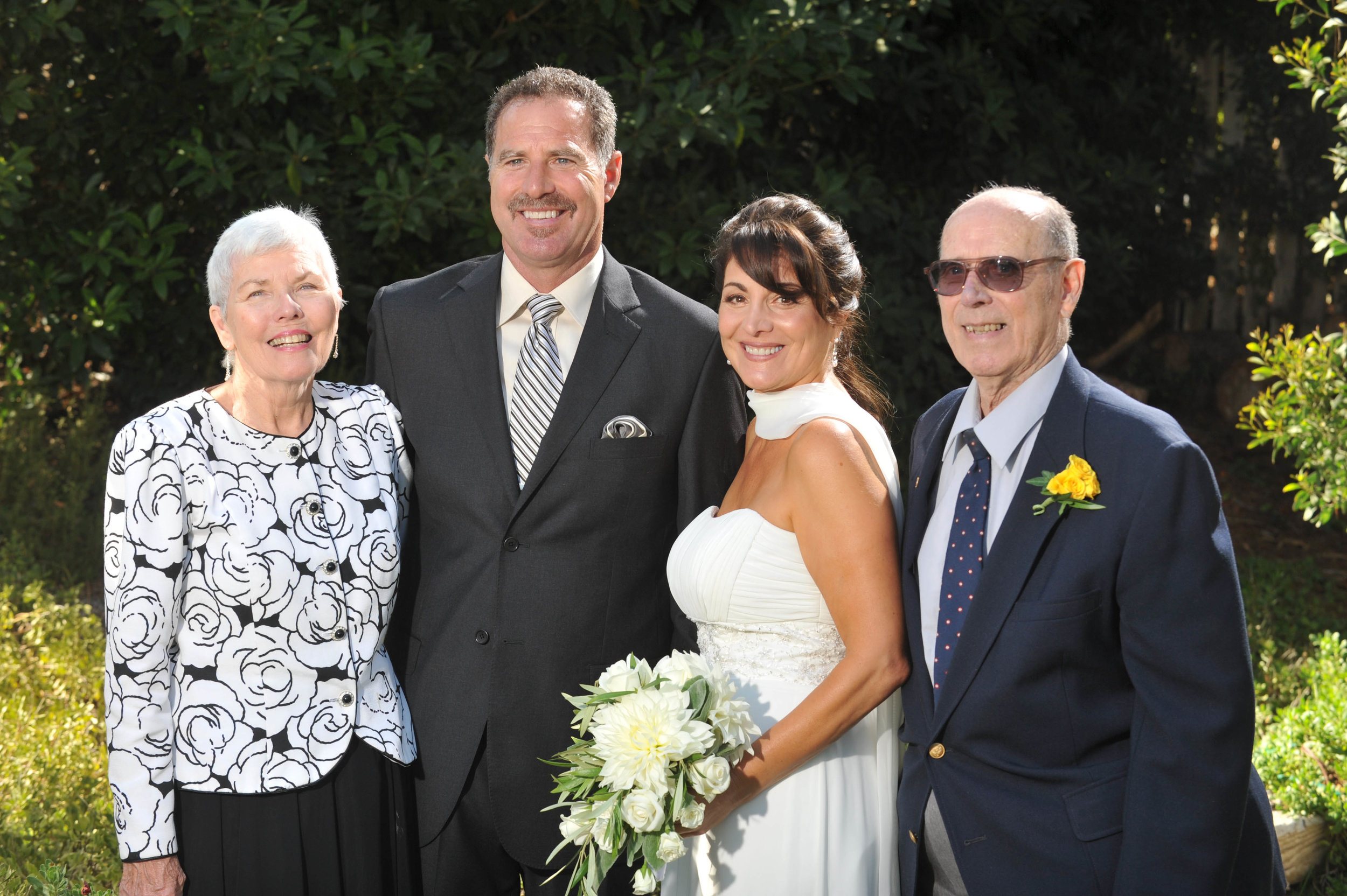 Tina, second from right, with her handsome husband, second from left, on their wedding day. On right is the best Chief of Police. On left, Tina's mother-in-law.