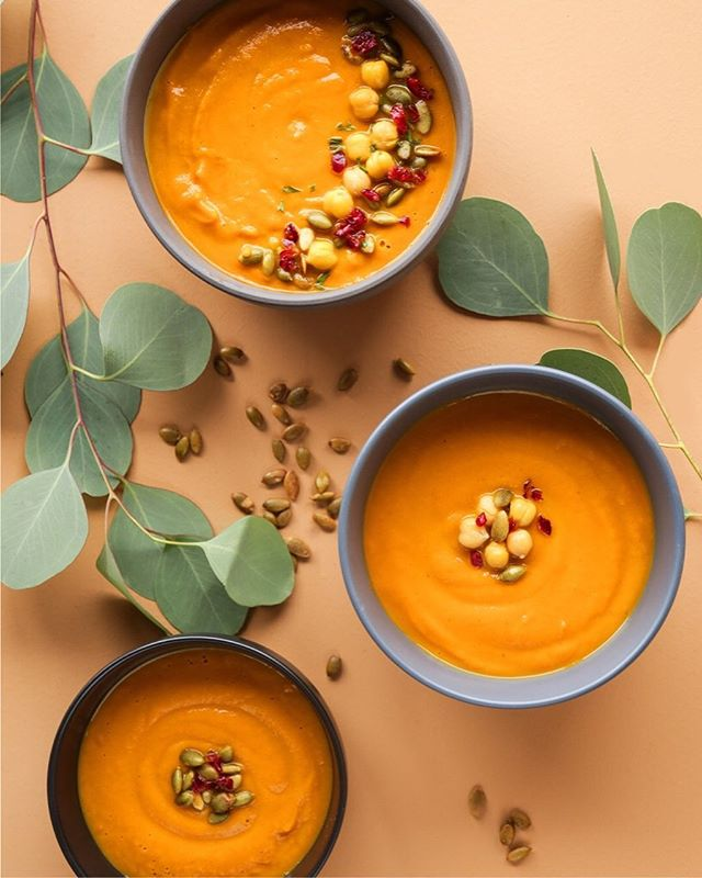 Nothing says Autumn more than a bowl of creamy & delicious pumpkin soup. 🤤  _  Ingredients 1 Tablespoon Olive Oil 1 Tablespoon Butter, unsalted 1 1/2 Cups Garbanzo Beans – canned, drained and rinsed 1/2 Onion, raw – sliced 3 Garlic, clove 2 Cups Pumpkin Puree, canned – or one 15-oz can 2 Cups Vegetable Broth, low-sodium 1 Teaspoon Ginger Root, ground 1/8 Teaspoon Nutmeg, ground 1/8 Teaspoon Clove, ground 1/2 Teaspoon Sea Salt – or to taste 1/4 Teaspoon Black Pepper, ground – or to taste 1/2 Cup Heavy Cream  Directions Heat oil and butter in a pot, and sauté chickpeas, onion, and garlic until soft. Mix in spices and set aside to cool. When cooled completely, add all ingredients except for the cream. Blend for 30 seconds or until smooth. Pour back into the pot and add 1/2 cup of cream. Simmer for 10 minutes. Enjoy!