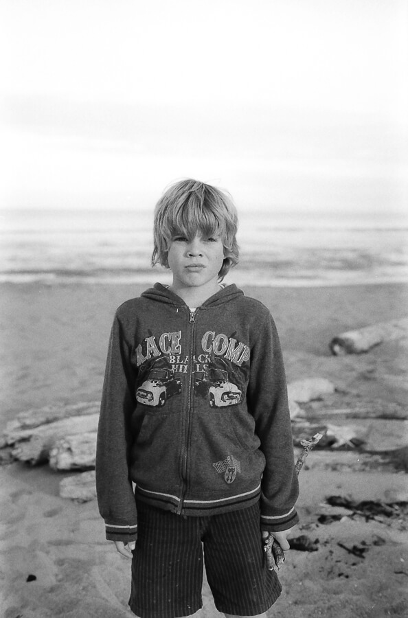 seeing a way back - boy collecting sticks on the beach.jpg