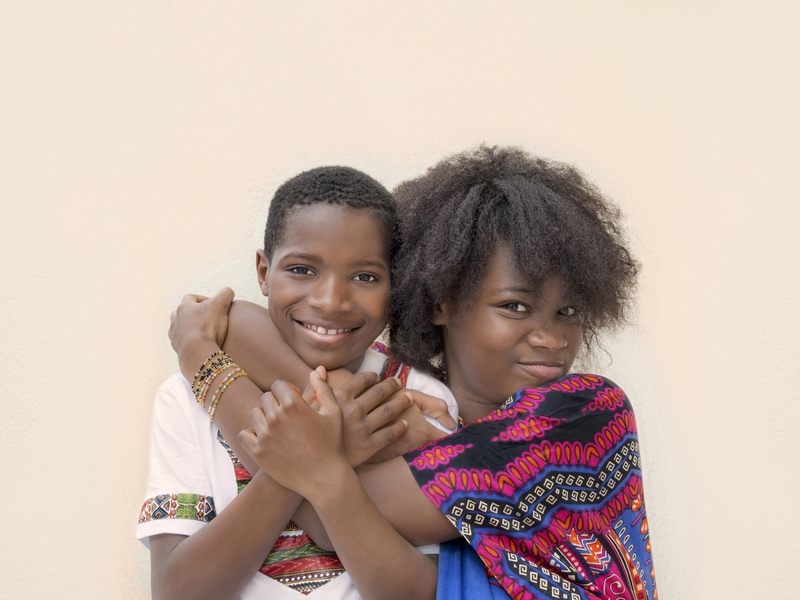 Two Girls Embracing in Uganda