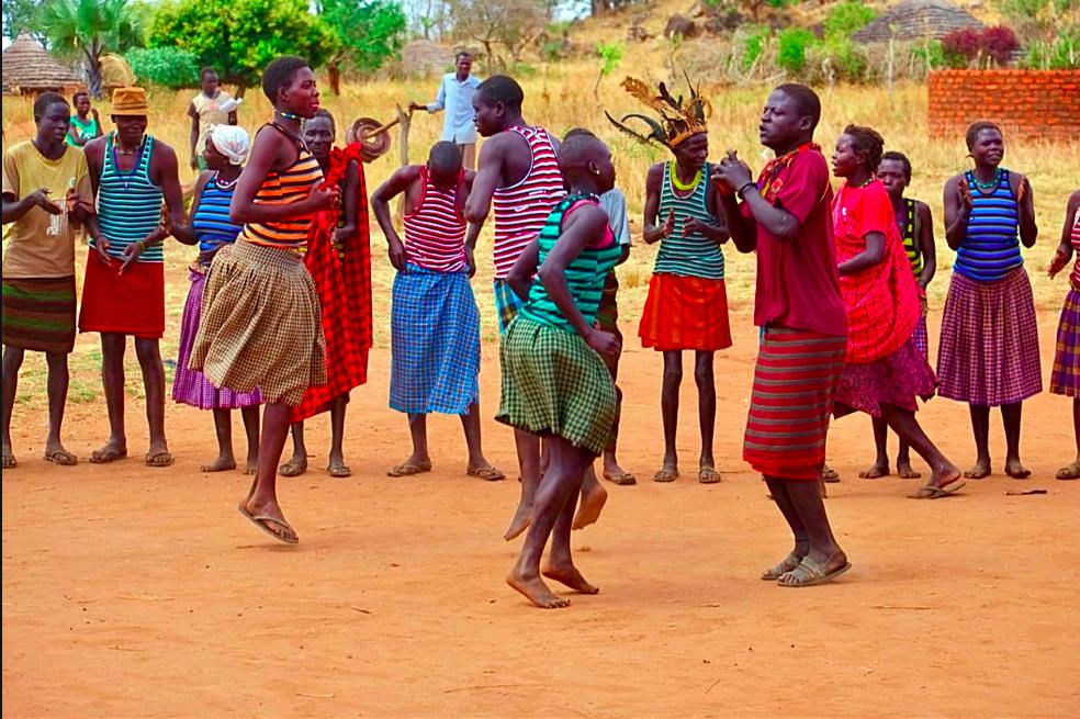 Dancing in the communities of Uganda (photo credit @Azim Abdullah)
