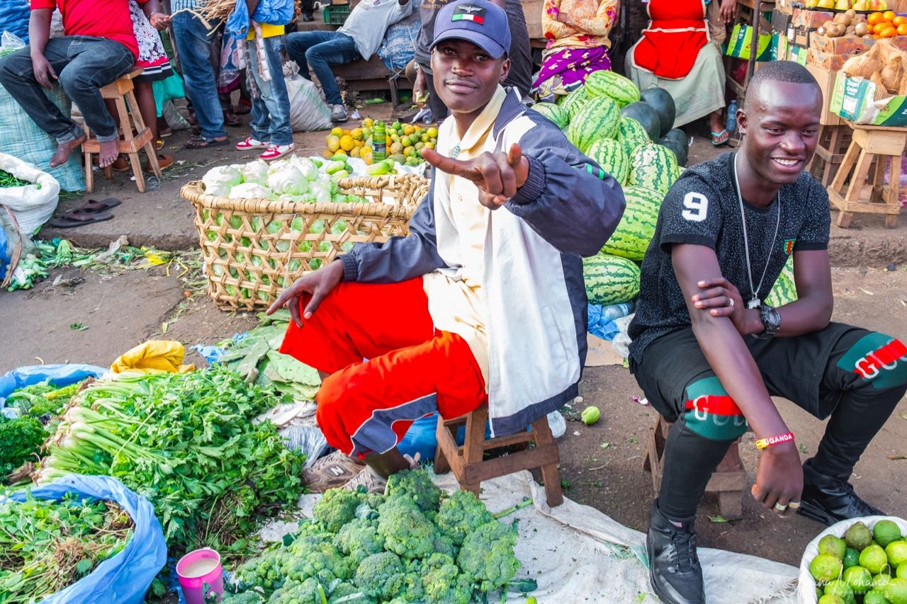 Two men selling fruit and vegetables at Nakasero Market, Kampala