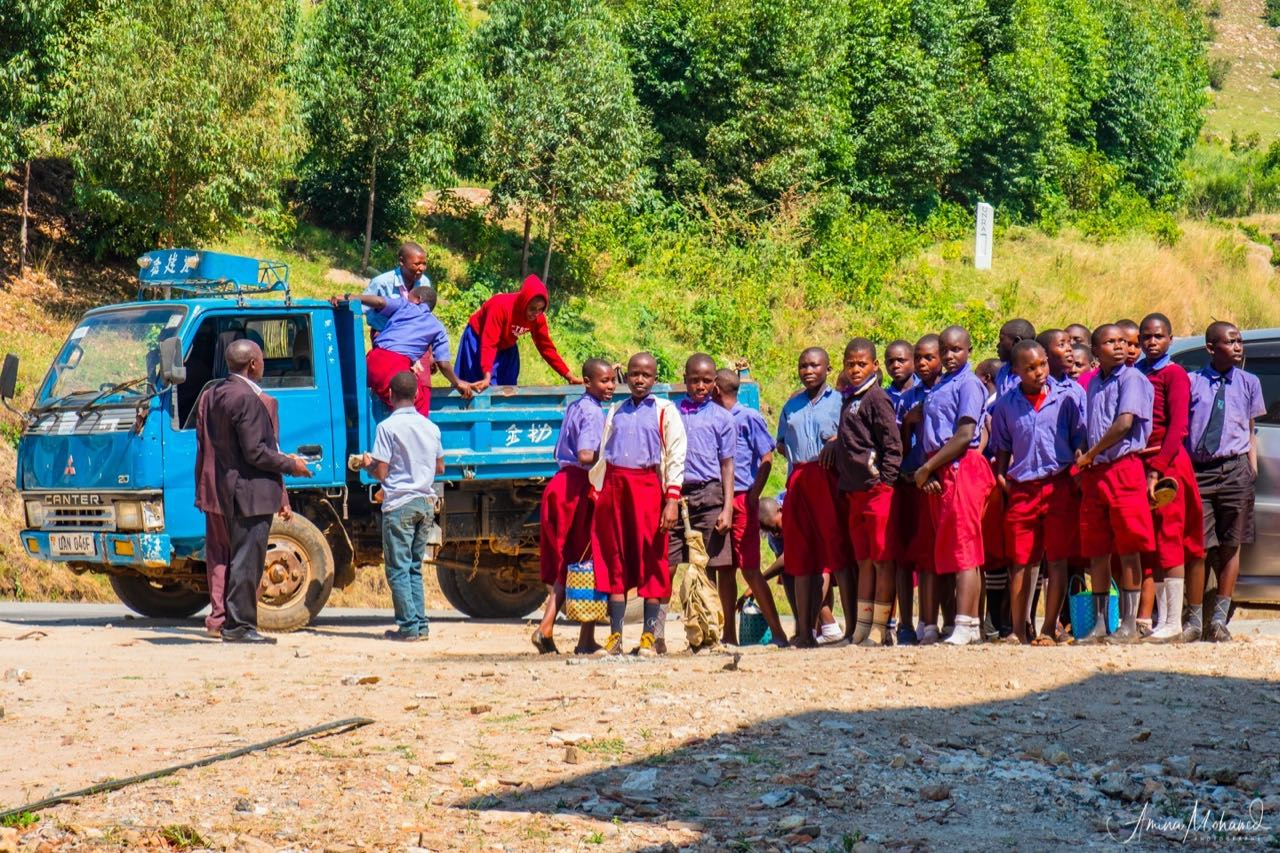 School-children traveling on an excursion via flatbed truck, Fort Portal, Uganda