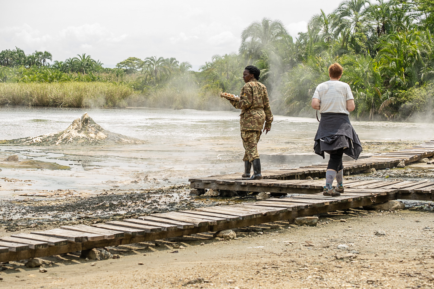 Kim walking with our guide Harriet to boil eggs in the femaie hot springs, Semiliki National Park, Uganda image copyright @triplefphototours