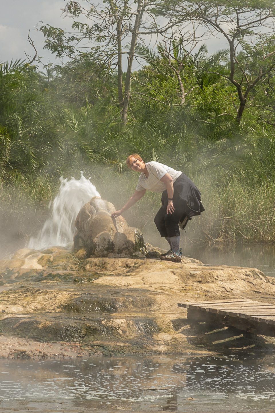 Kim touching the gyser at the female hot springs, Semiliki  copyright @ triple f photo tours