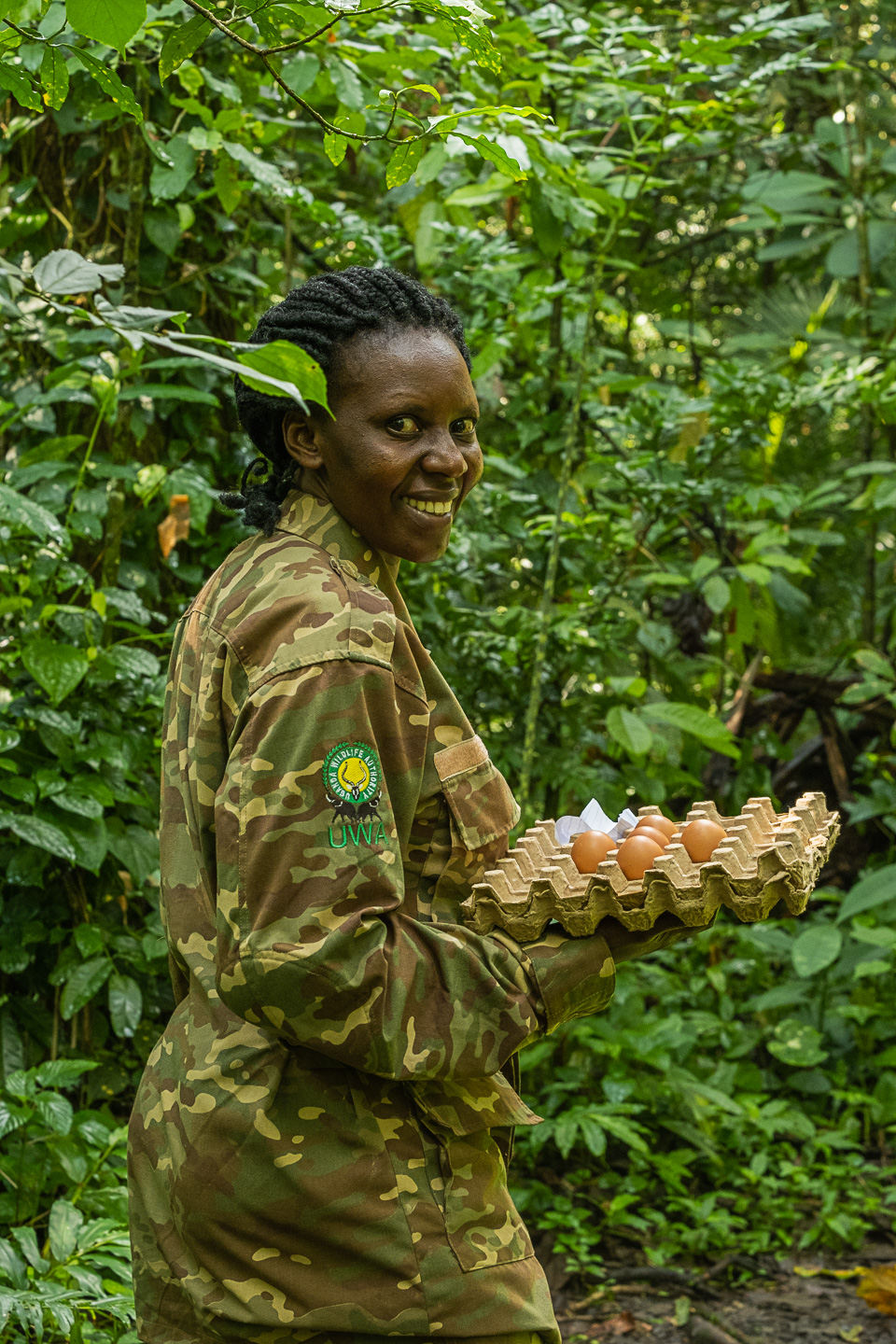 Our guide Harriet leading us through the forest at Semiliki while carrying the precious eggs  image copyright @ triple f photo tours