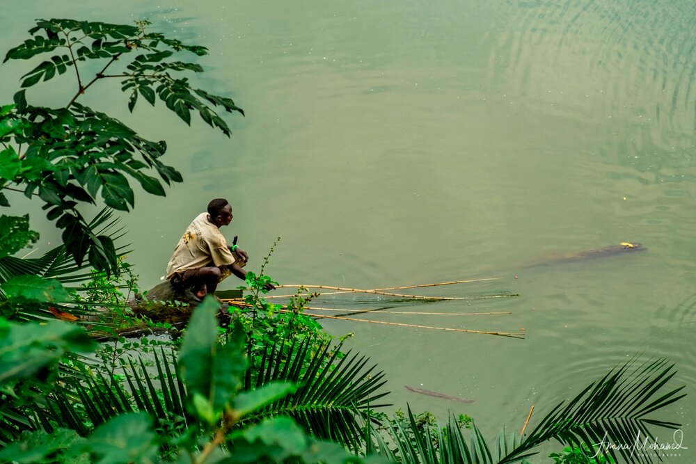 Fisherman in the water near Fort Portal, Uganda @Amina Mohamed Photography