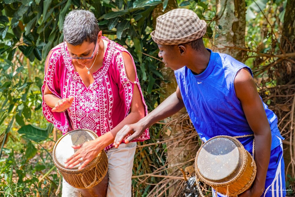 Me getting a drum lesson in Uganda