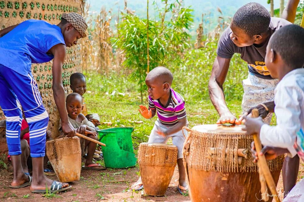 Kids in Bombo Town learning how to play the drums, Uganda @Amina Mohamed Photography