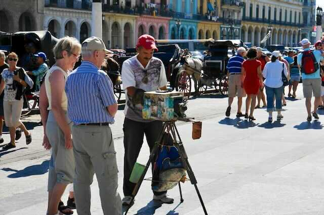 Photographer in Cuba using old school methods @Amina Mohamed Photography