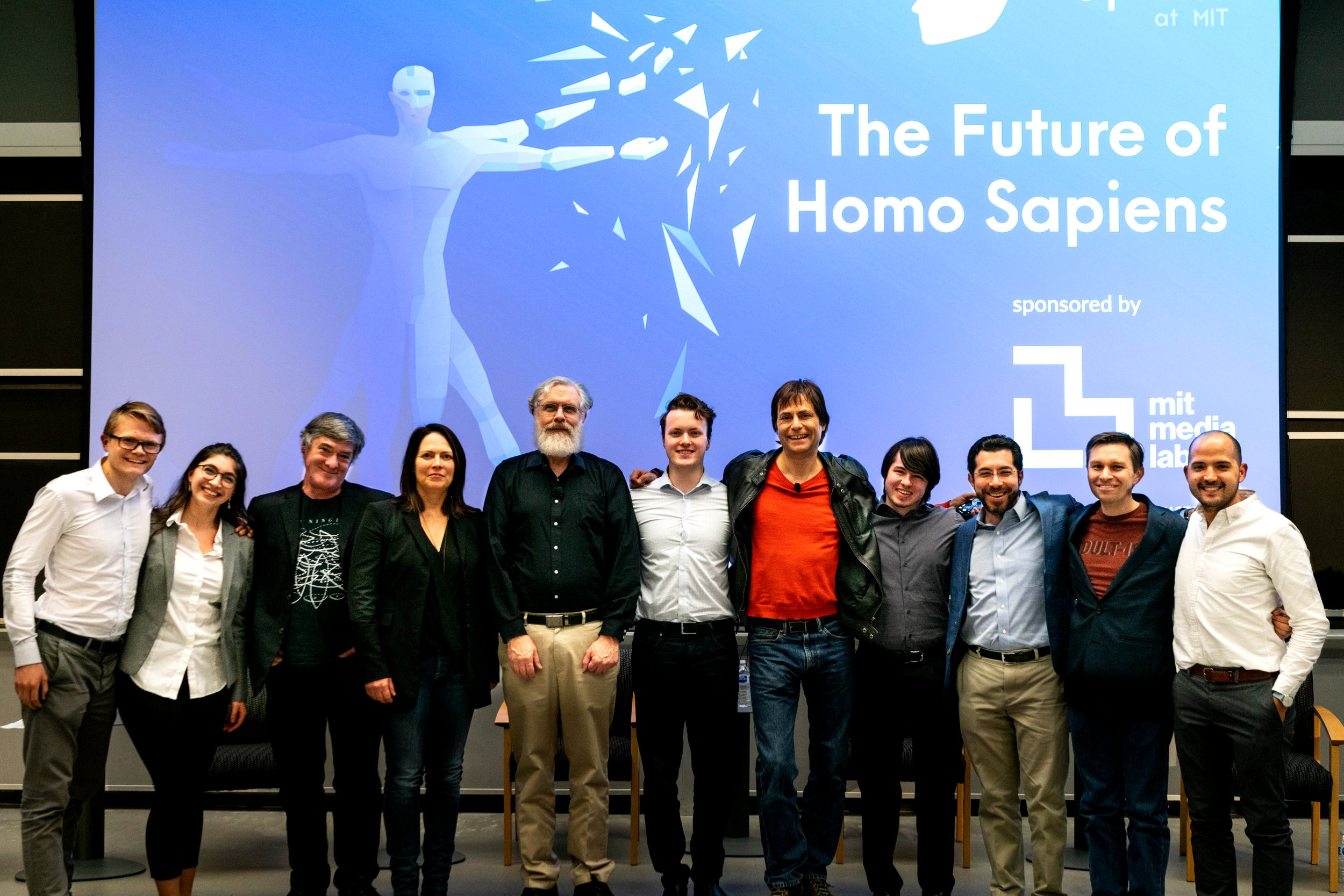 "Xapiens founding team at the ""Future of Homo Sapiens"" symposium with the panelists. From left to right:  Mathias Backaether, Siranush Babakhanova, Joe Paradiso, Pattie Maes, George Church, Logan H Ford, Max Tegmark, Loyd H Waites, Ed Boyden, David Sinclair, MJ Antonini.  Photo taken by Lillie Paquette  from MIT School of Engineering  on March 7th 2018 ."