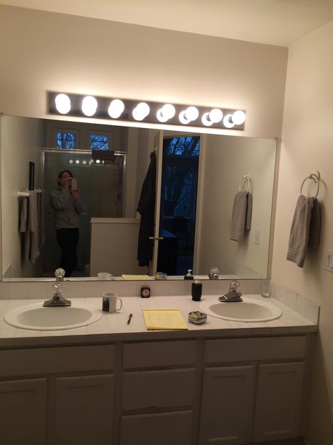 Before: Outdated lighting and fixtures.