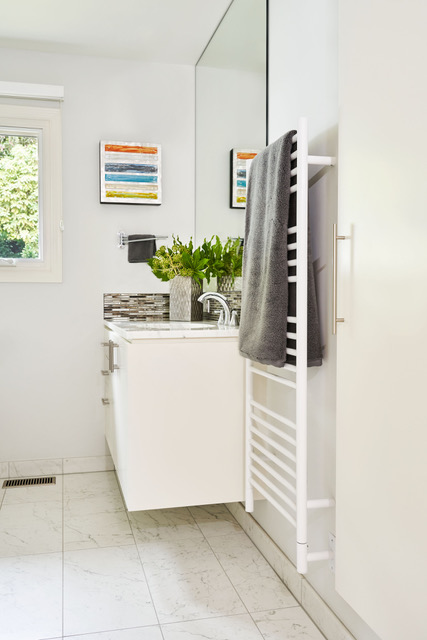 Towel warmer adds both storage and luxury.