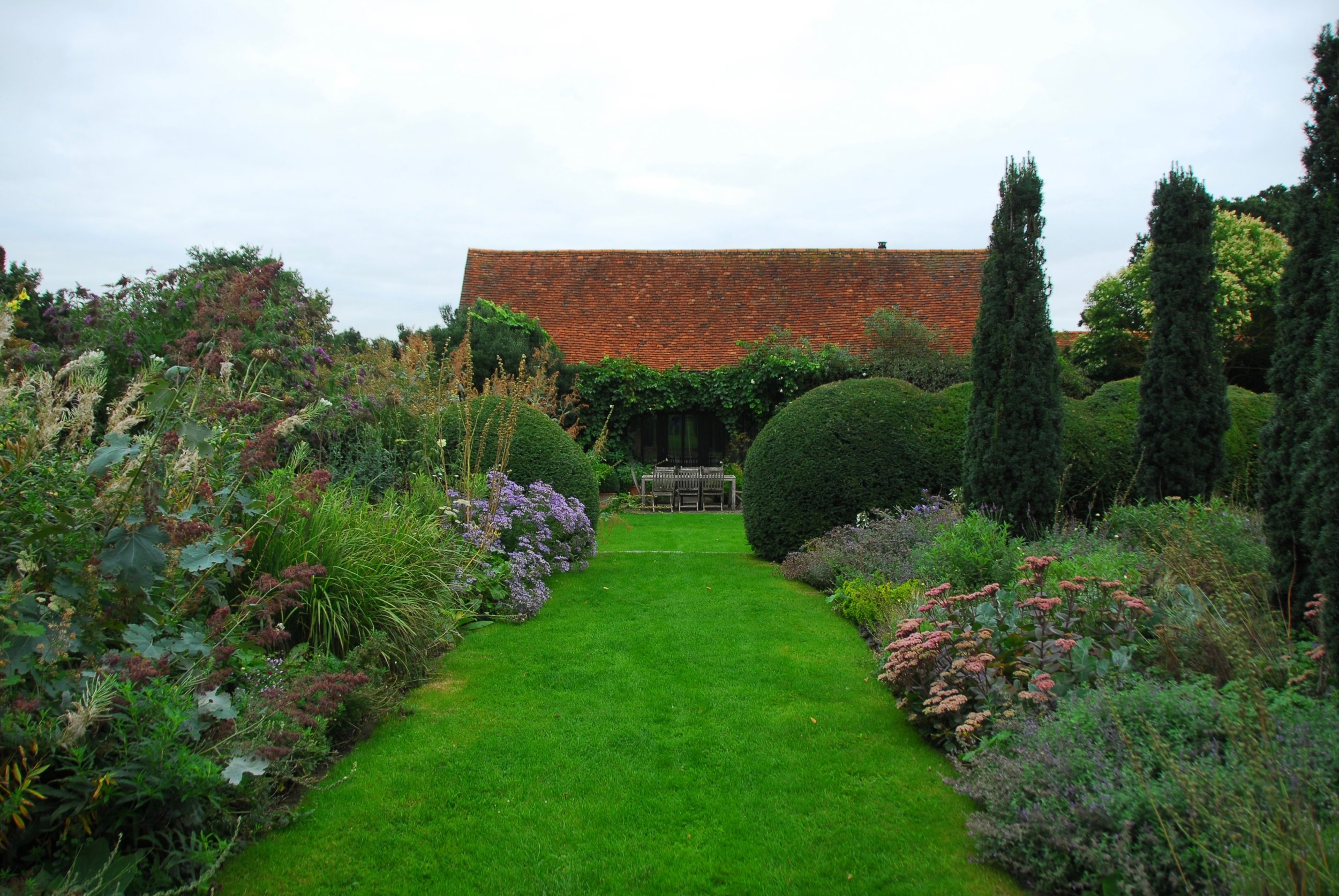 """THE BARN   """"The home of designer Tom Stuart-Smith, and provides an intimate insight into his own evolution and experimentation, from his signature combinations of clipped plants amongst very soft perennials plantings, through to recent work with direct-sown prairie."""""""