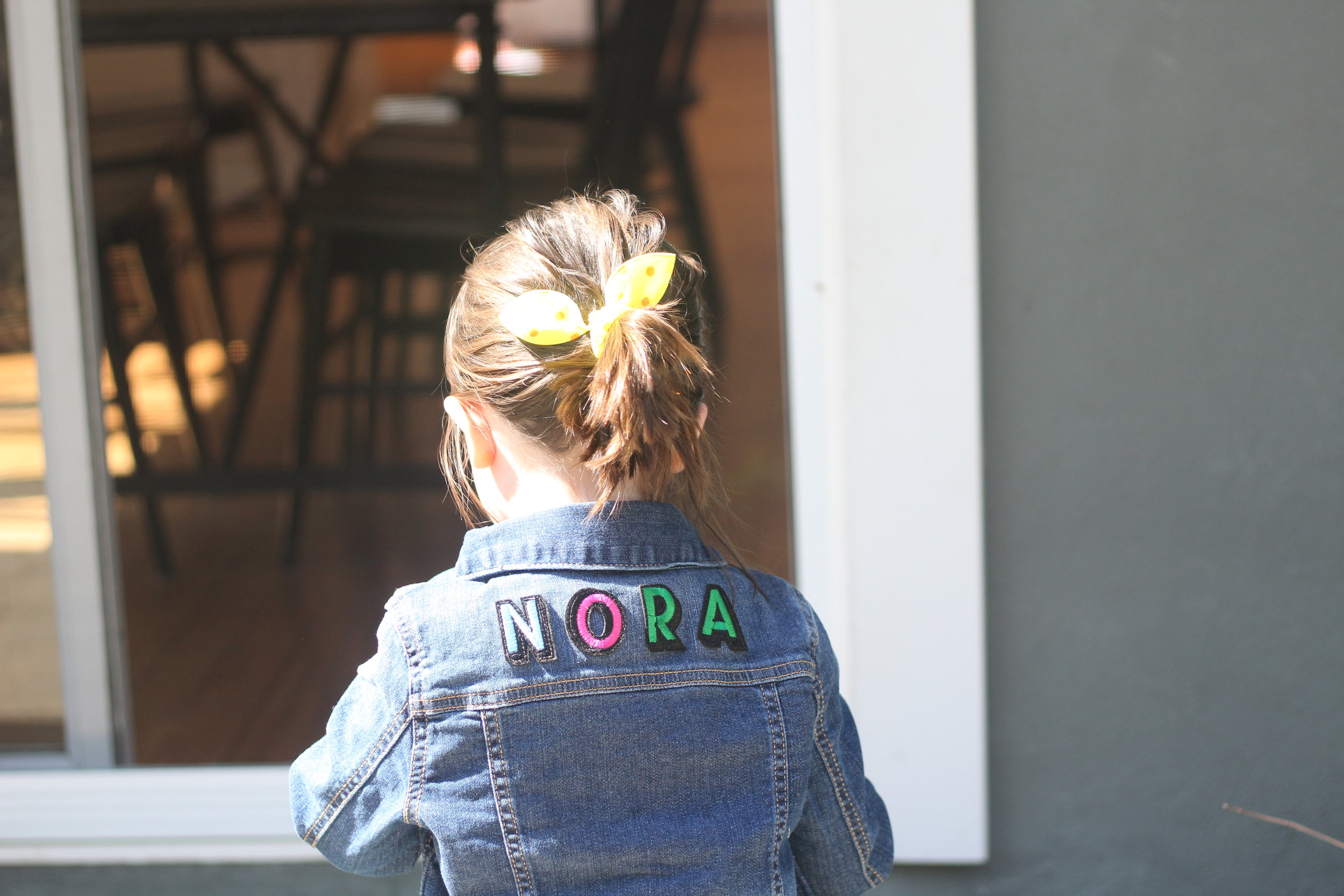 "Nora wearing her  jacket ! I only wish the ""R"" and ""A"" would have been different colors!"