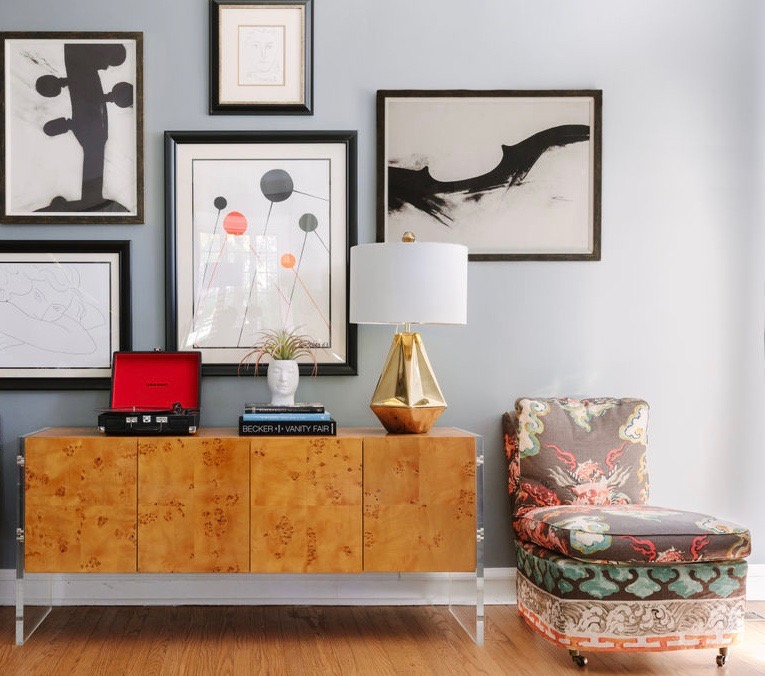 Chicago interior designer Jonathan Adler burled wood sideboard with lucite, Artfully Walls black and white art, dragon fabric