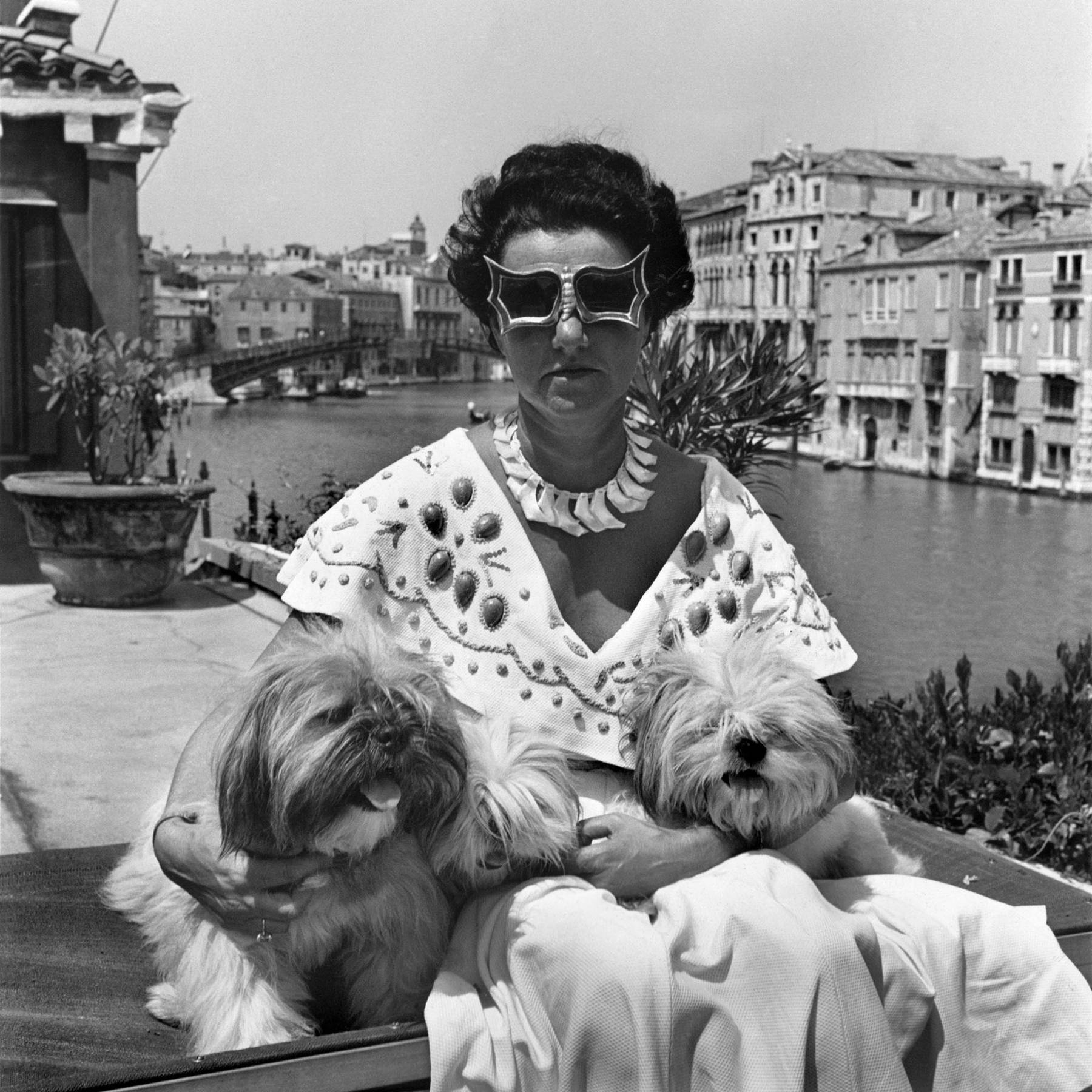 Guggenheim with her beloved pups and iconic sunglasses!