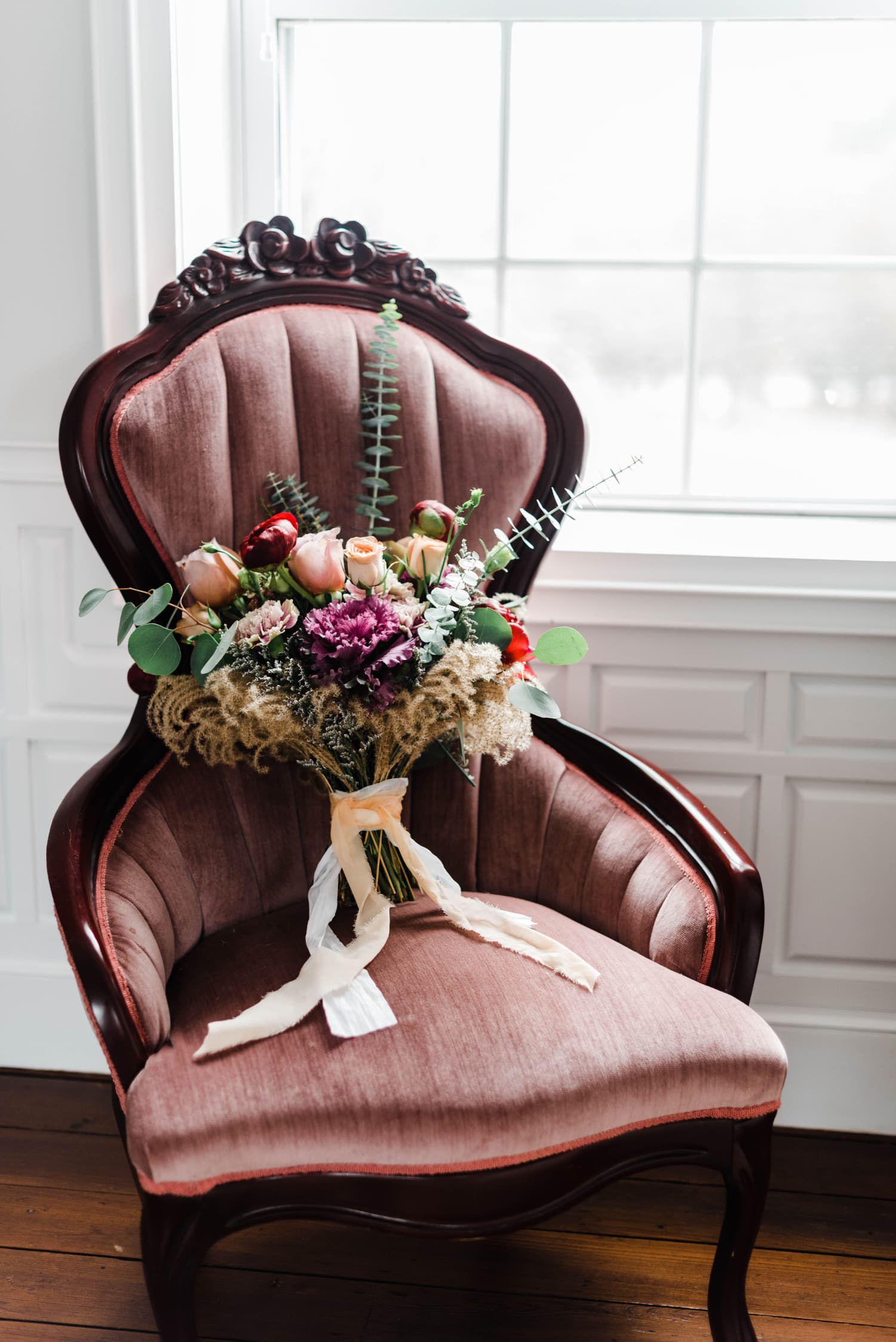 Chair with bride's bouquet at historic wedding venue in Virginia