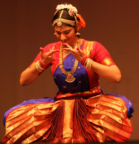 """Pudumai Penn - A Vision for the New Age Woman - 4:00pm Anthony Soto Theater, San JoseSaturday, November 21st, 2009Press: San Jose Mercury NewsAs part of a $3000 yearlong grant Ambika received from the Alliance for California Traditional Arts to further studies in Indian classical dance, Ambika was tasked with putting on a performance to showcase what she had learned in the year. She used the performance as a platform to raise funds and awareness for two domestic violence shelters – Asian Women's Home and Maitri.Ambika established a theme of women's empowerment for the performance. She used verses from Subramanya Bharathiar's poetry in her dance pieces. Bharathiar was an early 1900s Indian poet from Tamil Nadu, who wrote about the independence, free will, and intelligence of the Pudumai Penn, which means """"new age woman"""" in Tamil, an ancient Indian language. $5000 was raised in one evening to support the two domestic violence shelters."""