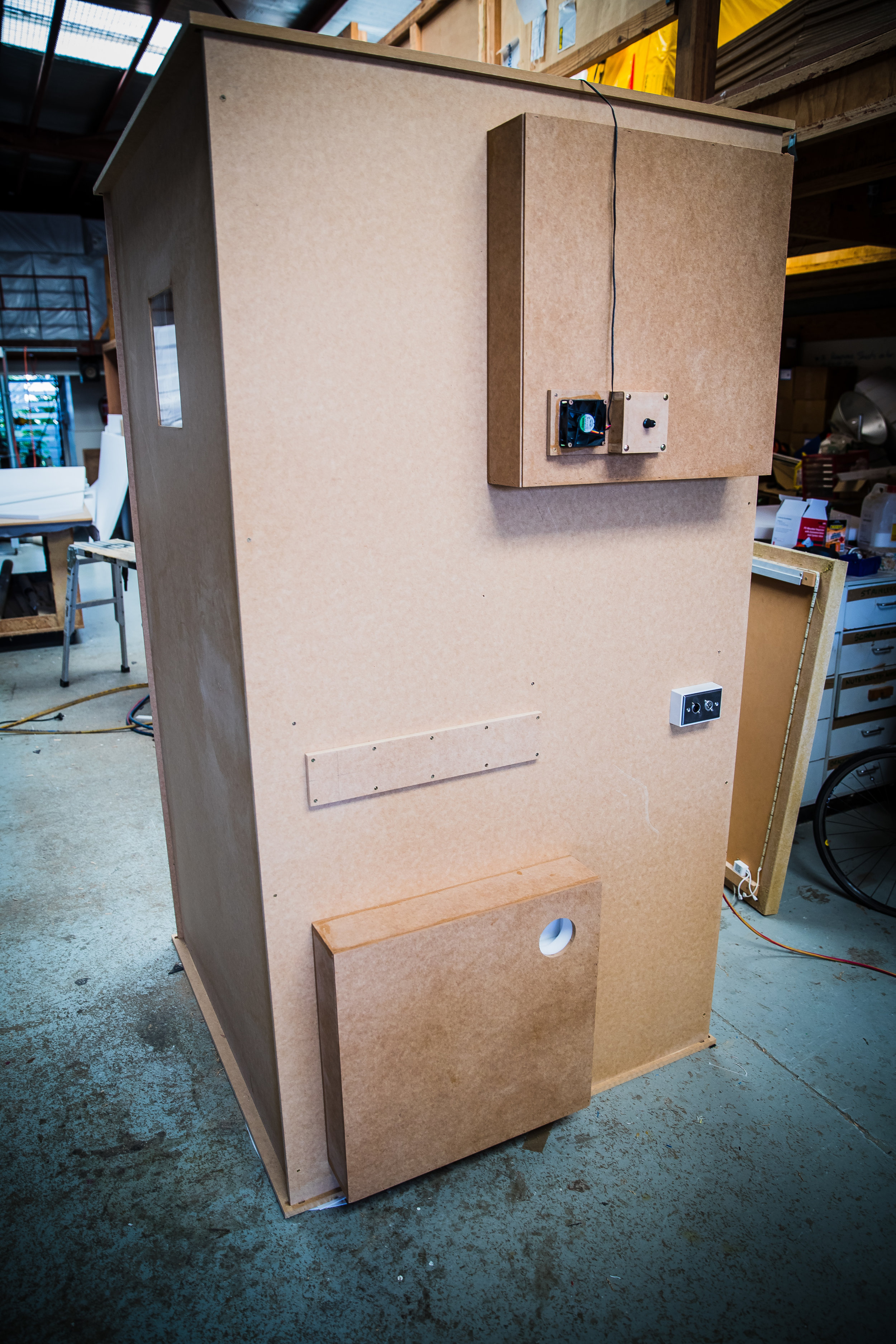 Rear of vocal booth with ventilation boxes and patch bay