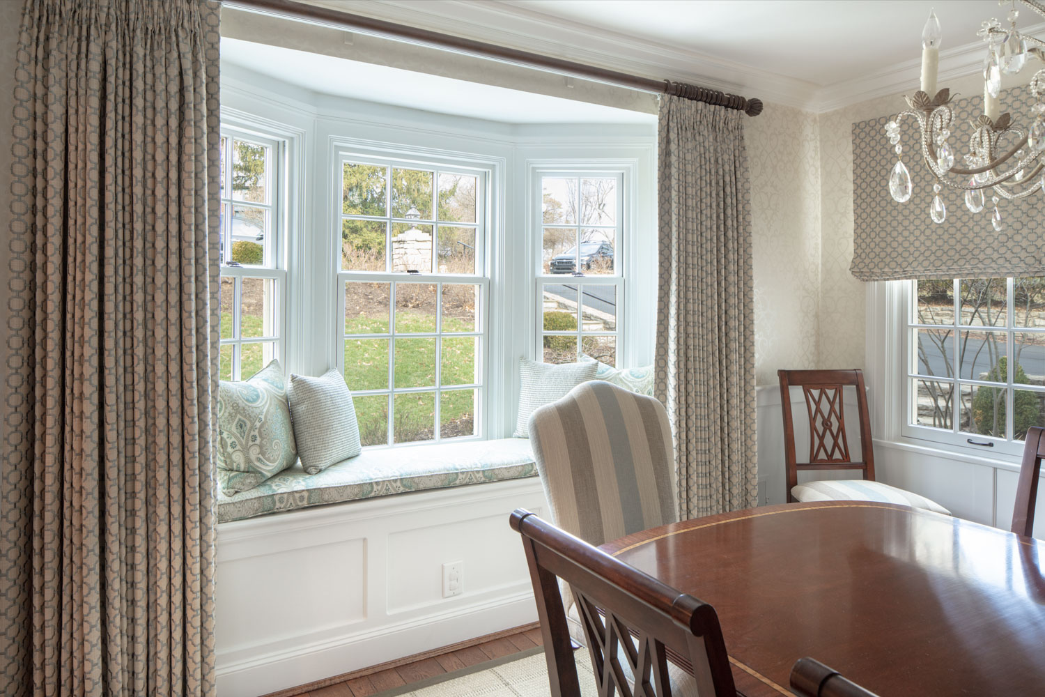 Wooden dining table and window seat with curtain