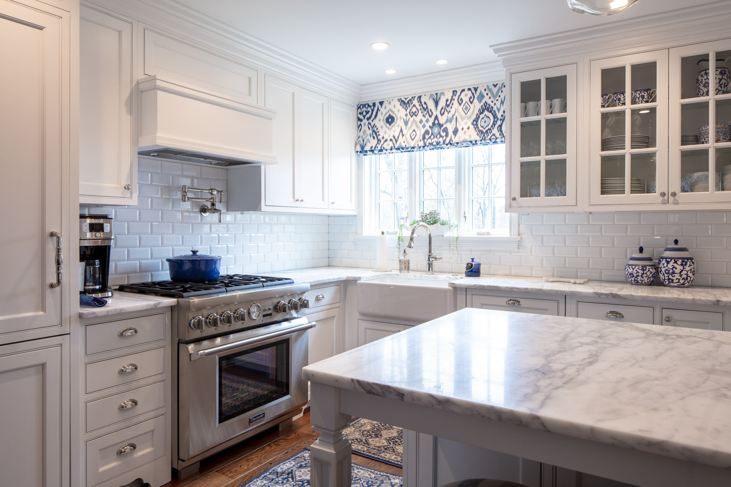 Modern kitchen with granite countertop island and white shelves