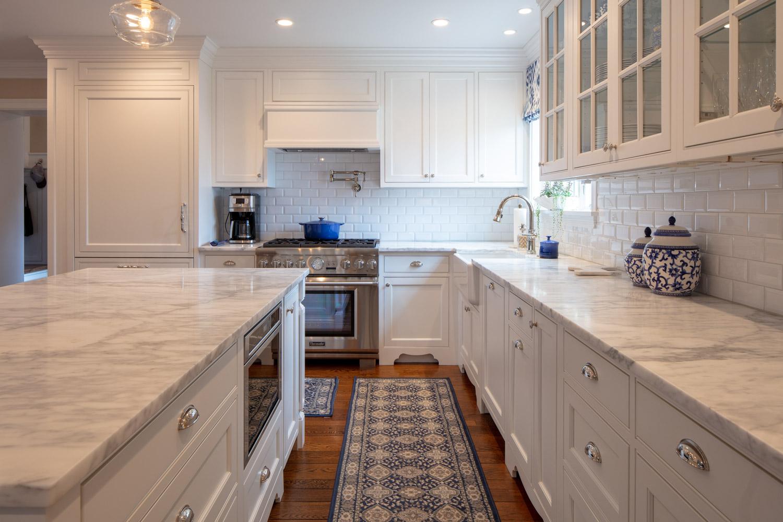 White modern style kitchen with granite countertops