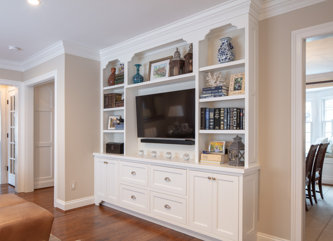Wooden white cabinet with TV and books