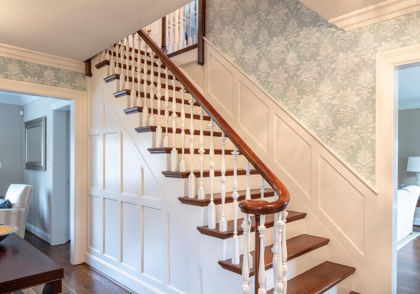 Modern house with interior wooden stairway