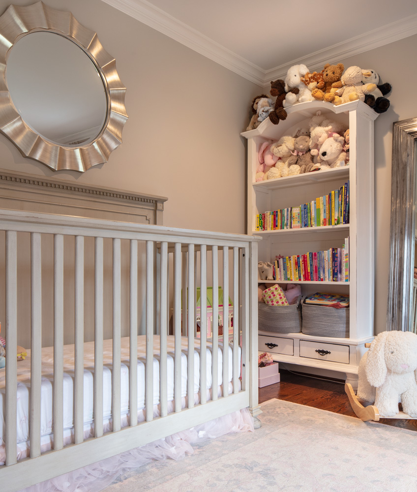 Modern child room with bed and round mirror on wall
