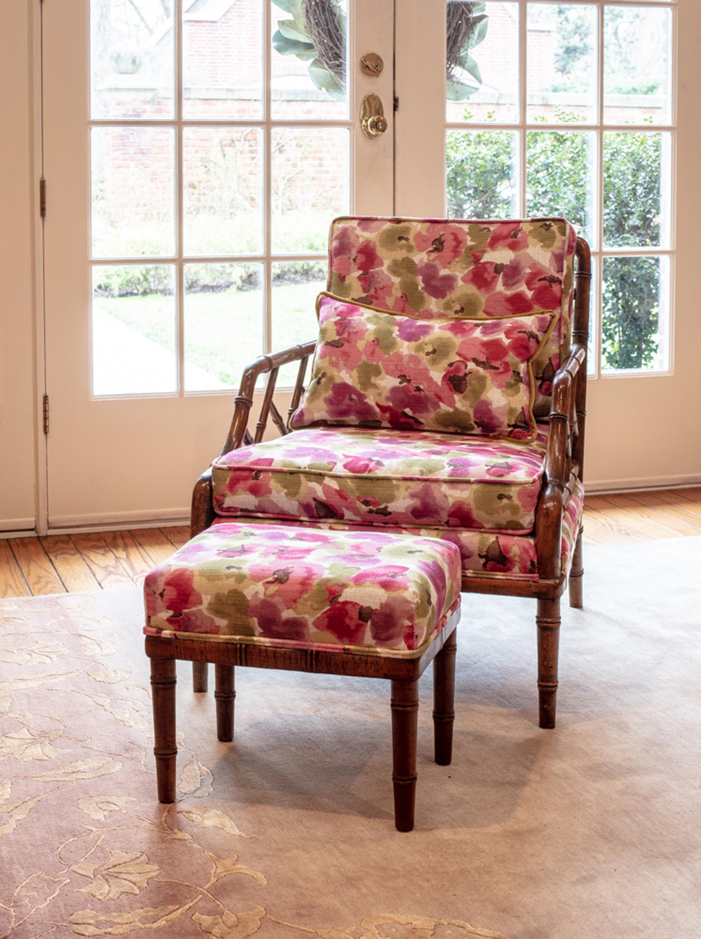 Floral chair and pillow and white wooden door