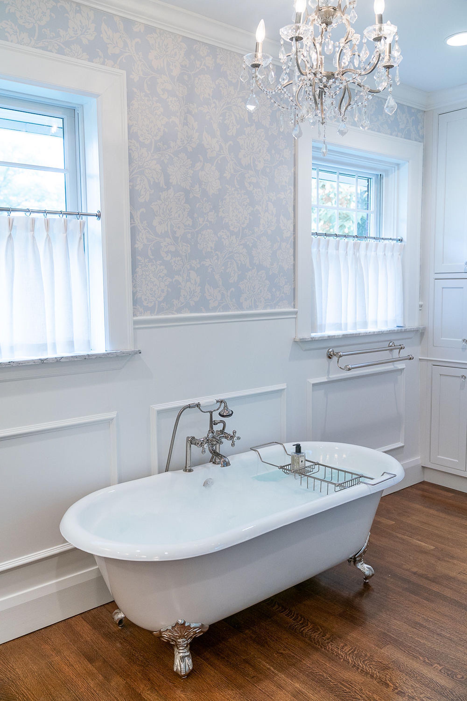 Elegant bathroom, hardwood floor and crystal chandelier