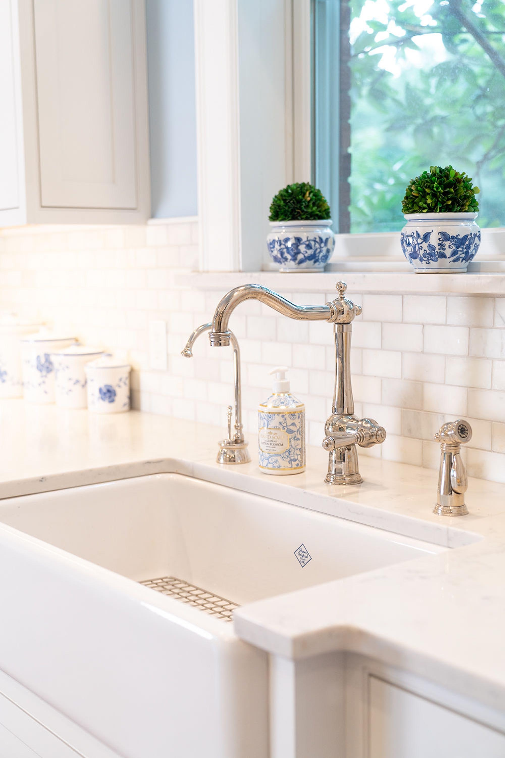 White kitchen sink and stainless faucet