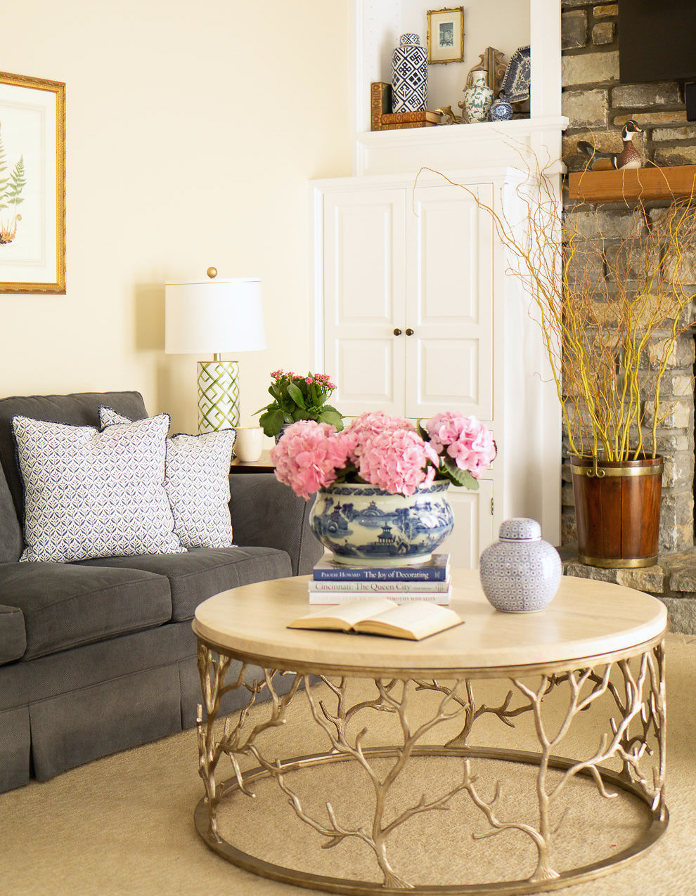 Living room with sofa, round center table and flower