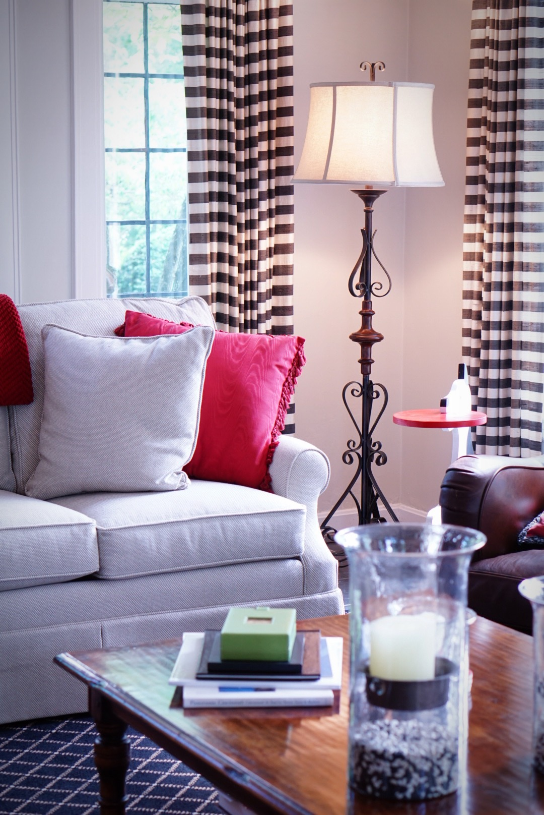 Living room with Sofa, wooden center table and classic floor lamp