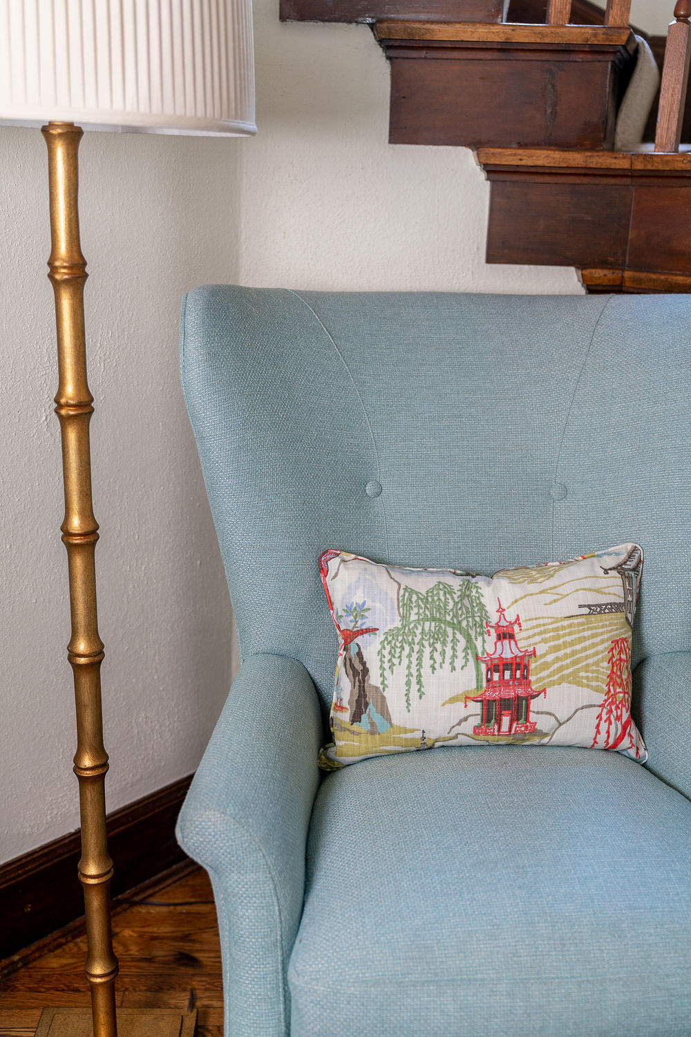 Armchair with pillow and golden lamp post