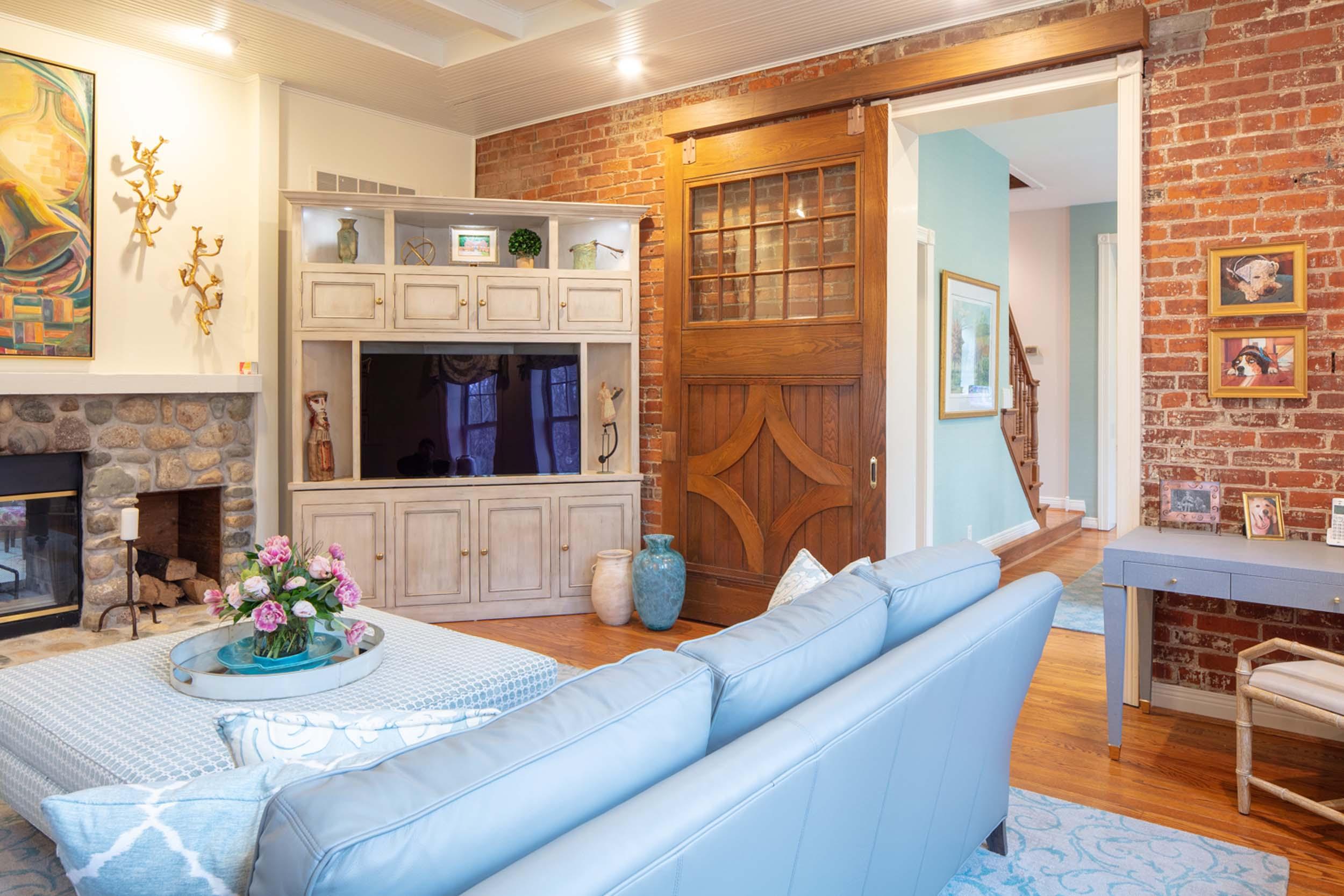 Modern living room with blue sofa and ottoman