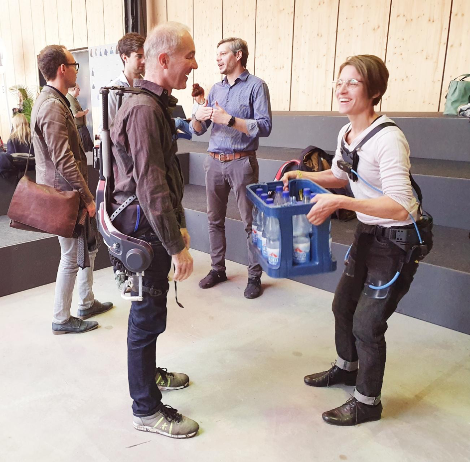 Members of the VDEI Scientific Committee, Prof. Herbert Schuster and Dr. Julia Schneider put the exoskeletons of German Bionic and Laevo to the test during the get-together session at re:publica 19.