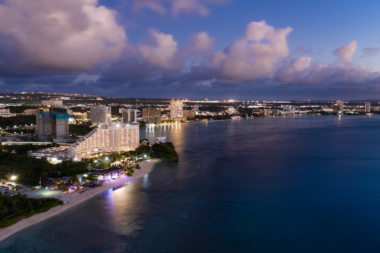 A jewel in the Pacific: Guam glitters in the night as travelers enjoy 24/7 shopping and other delights.