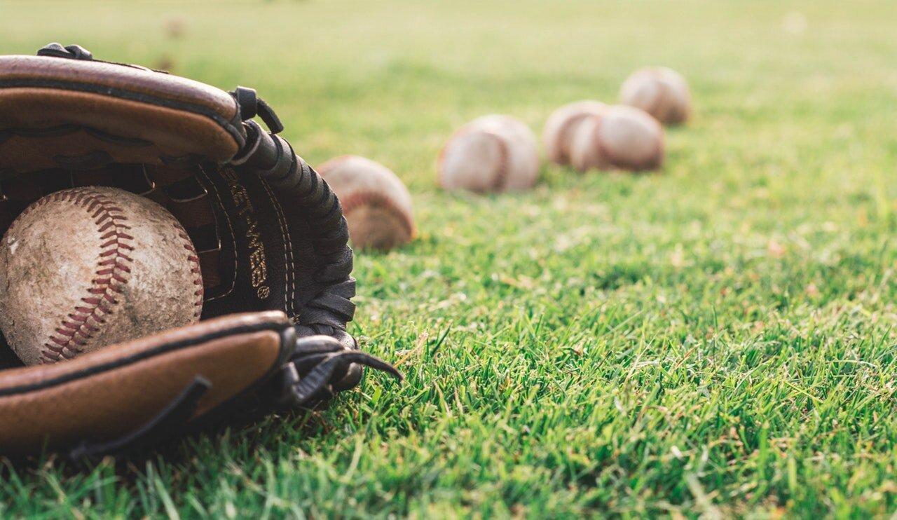 balls-baseball-glove-grass-1661950.jpg