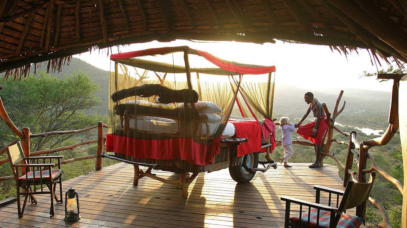 Loisaba-Star-Beds---little-girl-&-Samburu-guide-40.jpg