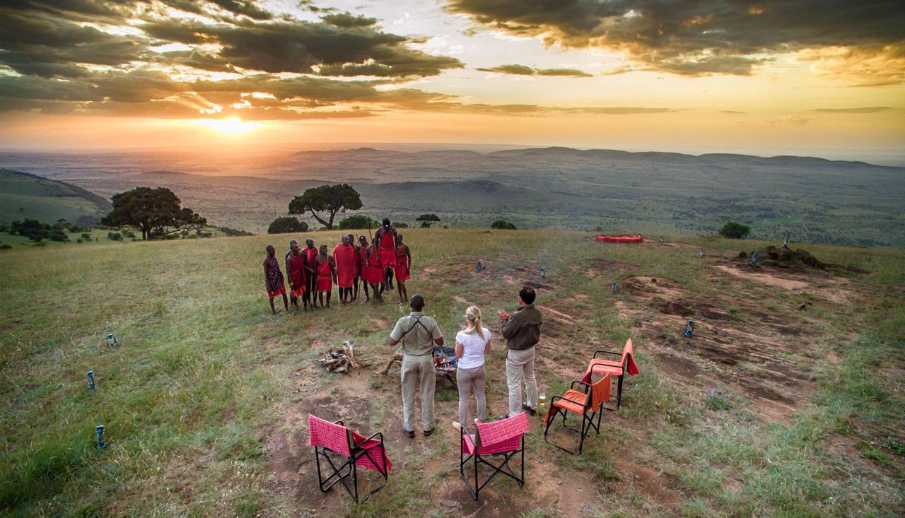 Maasai-warriors-on-the-edge-of-Ngorongoro-Crater-in-Tanzania-on-a-andBeyond-safari.jpg