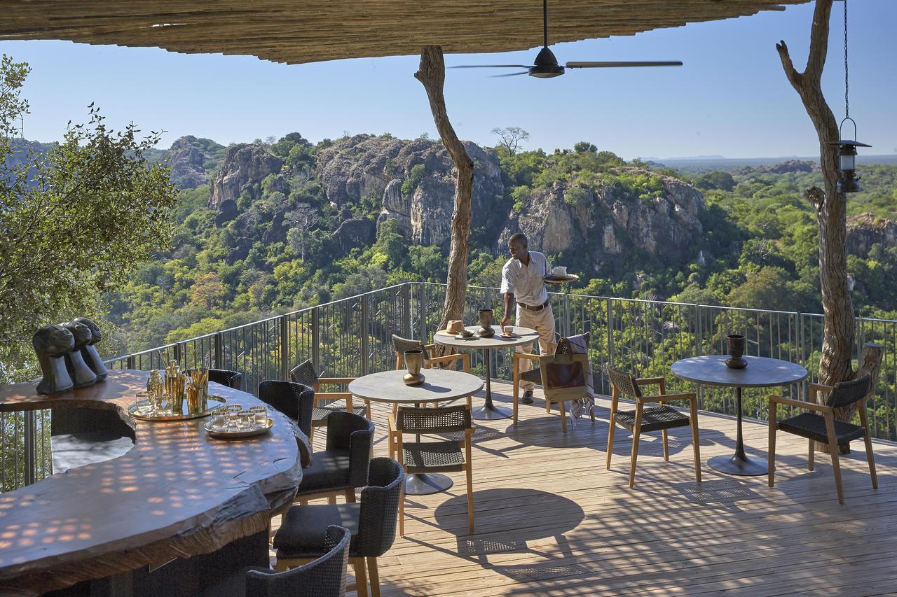 singita_pamushana_lodge_-_deck_overlooking_dam_with_waiter.jpg